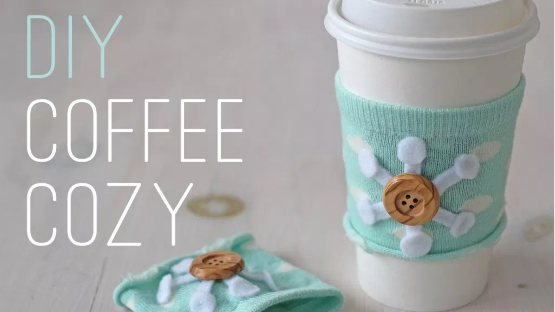 http://splashofsomething.com/2013/11/15/an-easy-peasy-no-sew-craft-to-keep-your-coffee-cozy/