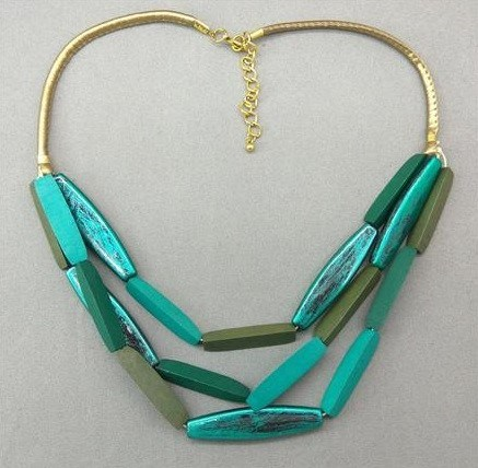 Green necklace with wooden beads from Grab Your Garb