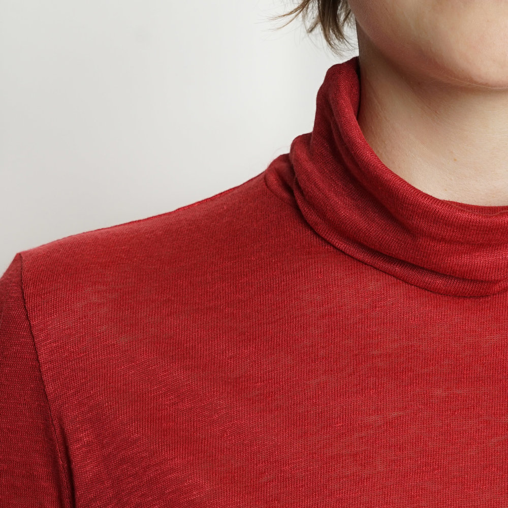 red turtle neck top from Silfir
